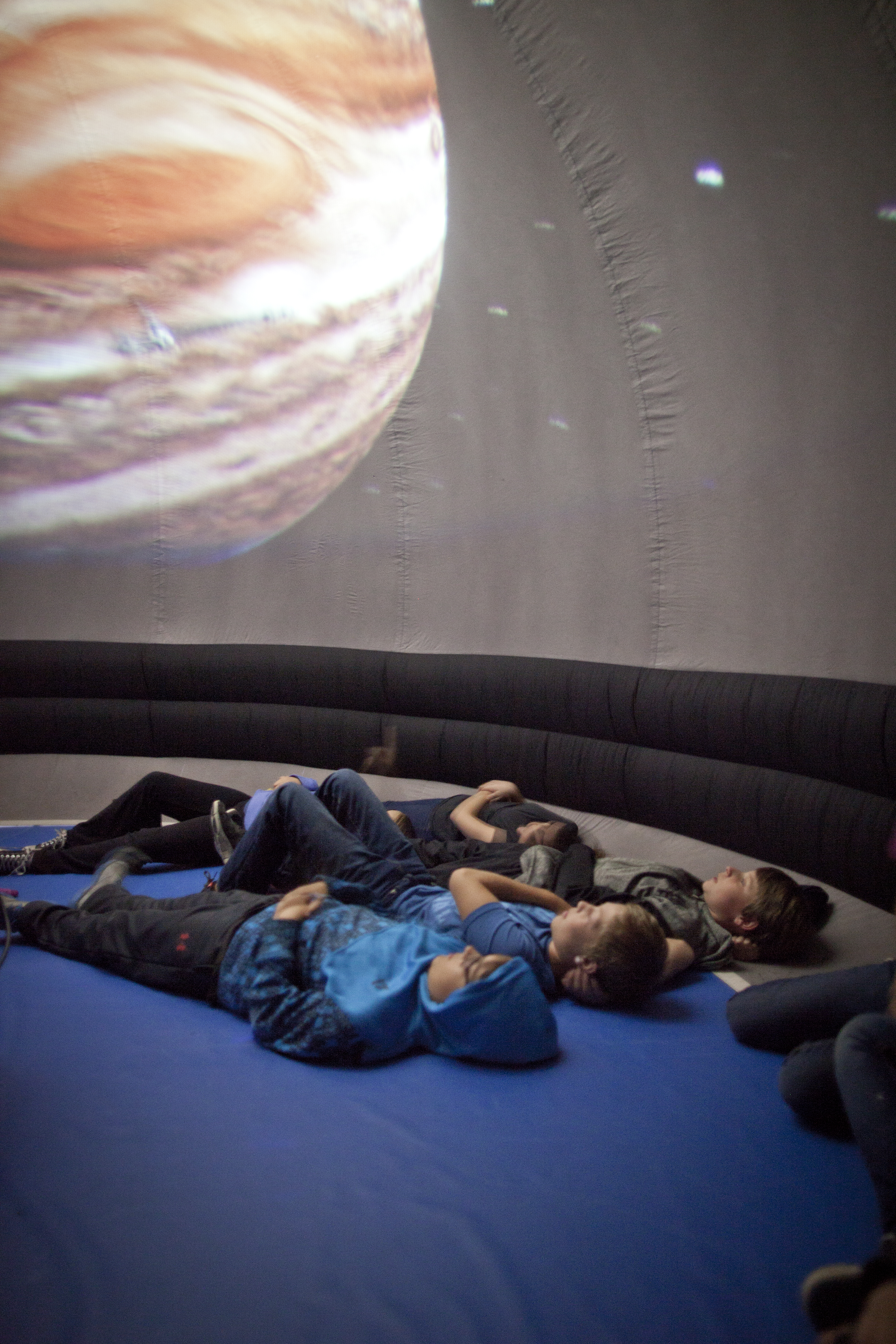 Students exploring other planets through Science North's planetarium presentation